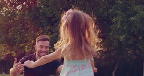 Father Embracing His Little Girl Running Toward Him In The Park At Sunset Family Happiness Beautiful Life Concept Slow Motion Shot On Red Epic 8K