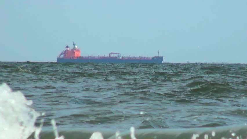 Cargo ship traveling along the sea