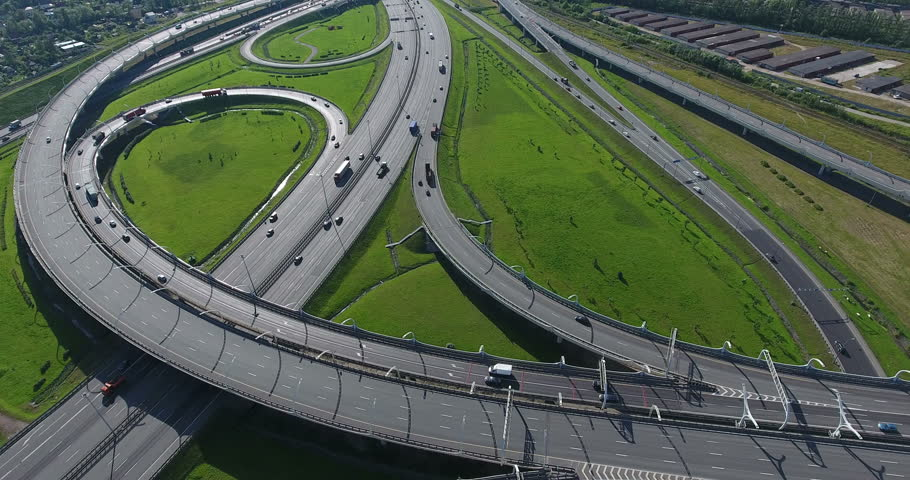 Traffic of urban multilevel highways and intersections of city ring road. Aerial view from above. Saint-Petersburg, Russia | Shutterstock HD Video #32307070