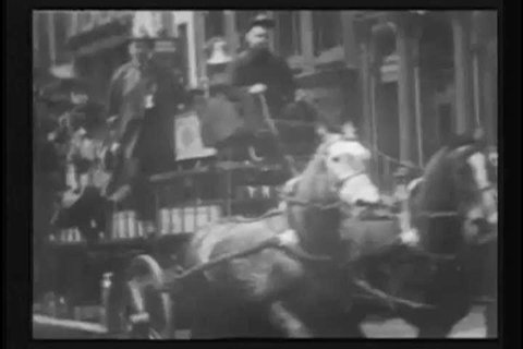 CIRCA 1900s - A single-angle street filming of the New York fire department on May 19, 1903, hurriedly returning from a fire as man-packed horse drawn carriages shuffle their extensive equipment
