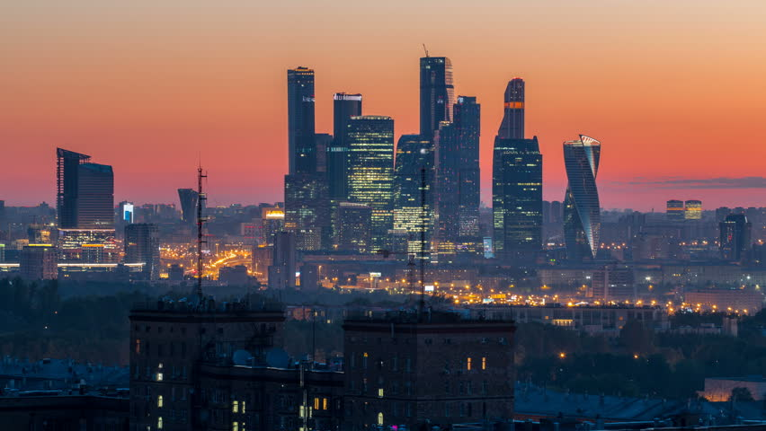 View from top of cityscape night to day transition timelapse, residential buildings, park areas, group of Moscow City skyscrapers in distance, horizon, morning mist before sunrise, Moscow, Russia | Shutterstock HD Video #32309230