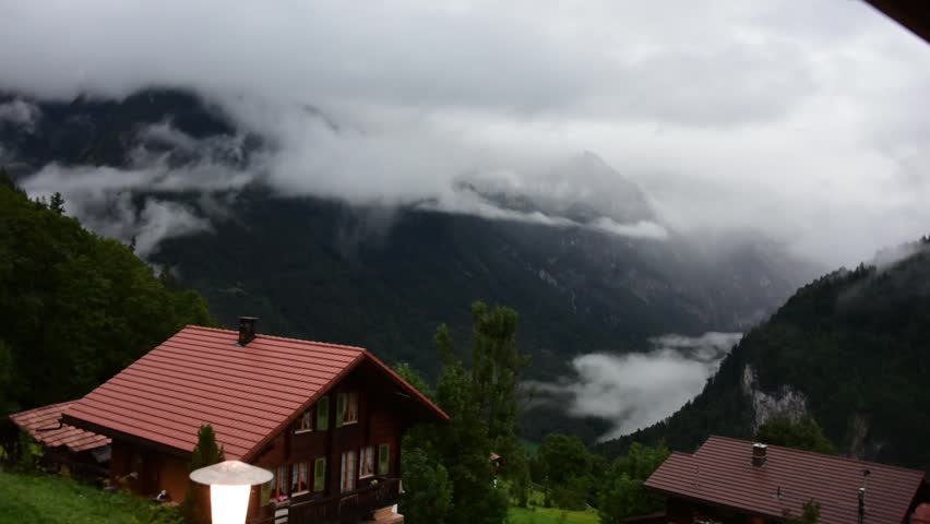 Timelapse of Beautiful Fog and Clouds Rolling Over Swiss Alps Village | Shutterstock HD Video #32314000