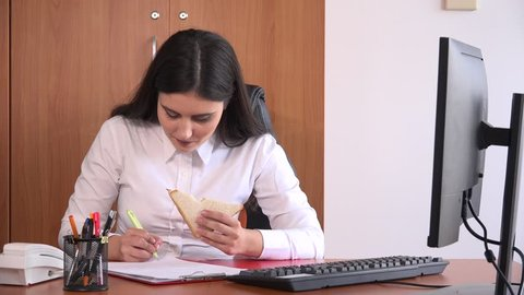 Busy occupied accountant business female consultant with paperwork sandwich food