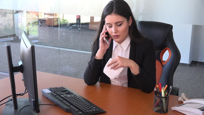 Sick cold flu business consultant female in the office blowing nose phone talk