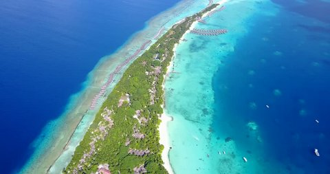 v12869 resort in maldives white sand beach tropical islands with drone aerial flying birds eye view with aqua blue sea water and sunny sky