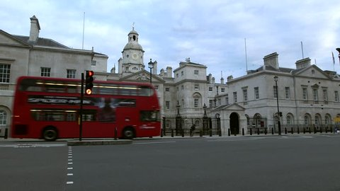 Whitehall Horse guards parade building early morning traffic red buses quiet street