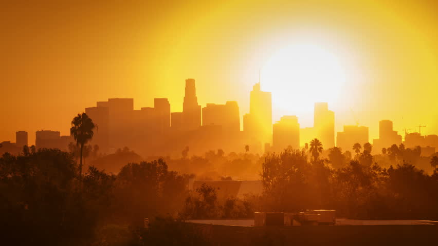 Sunrise over city, zoom in on modern downtown Los Angeles skyline buildings silhouettes. 4K UHD timelapse. | Shutterstock HD Video #32355820