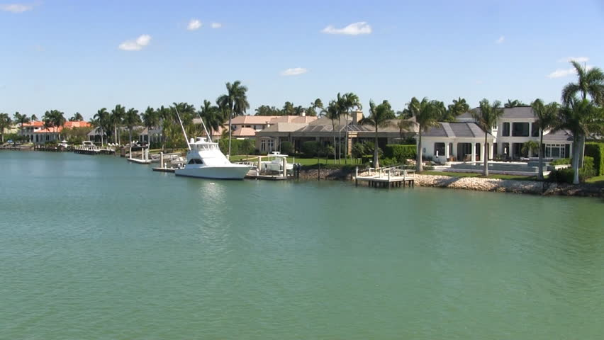 Waterfront affluent rich wealthy luxury homes mansions gated community exclusive high-end real-estate retirement intracoastal waterway Port Royal Naples Florida.