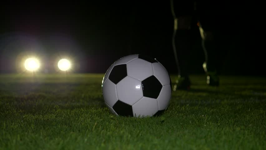 One Soccer Player Playing with Soccer Ball on Football Field at Night  | Shutterstock HD Video #32376580