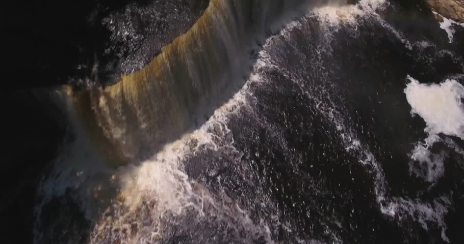4k Video flying backwards above Tahquamenon falls in northern Michigan 3