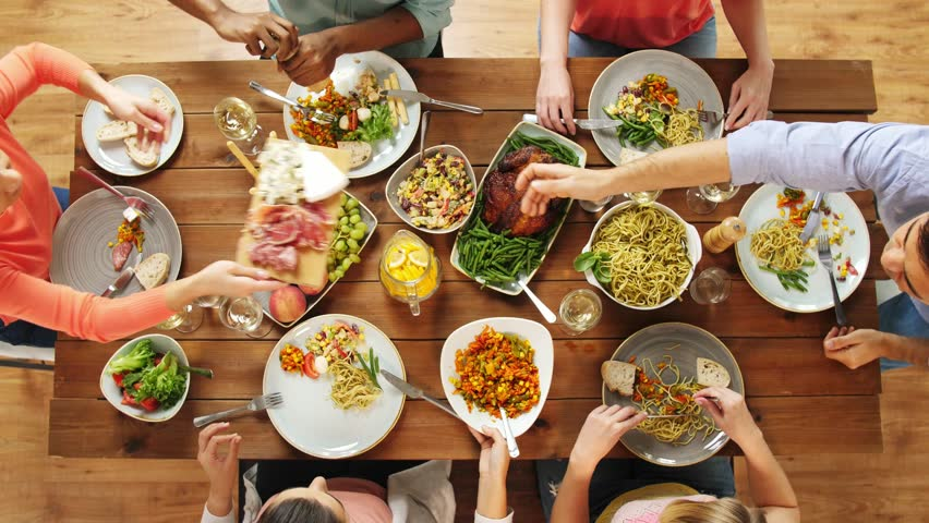 eating and leisure concept - group of people having dinner at table with food | Shutterstock Video #32420230