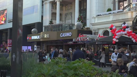 LONDON, ENGLAND - December 22: Centre London Cinema and Shopping Street in Leicester Square Theatreland in London People Walk Visit ( Ultra High Definition, Ultra HD, UHD, 4K, real time )