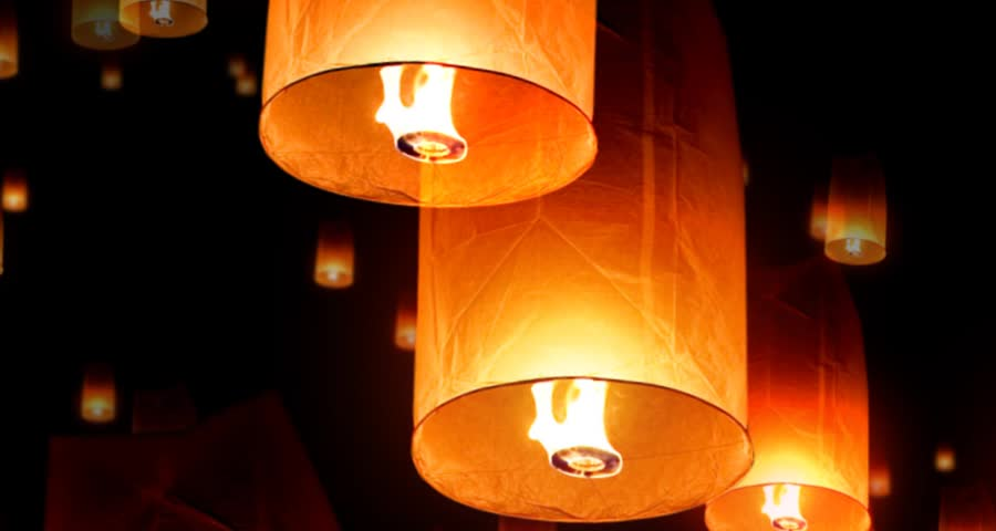 Fire lanterns floating up with black background