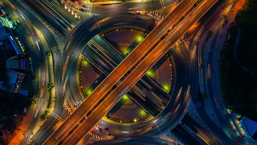 Aerial view Time lapse of the expressway, motorway and highway in the detail of circus intersection bangkok Thailand