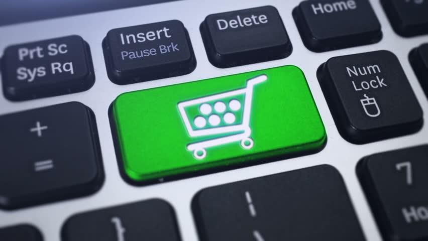 Online Shopping. Tracking shot of the computer keyboard key Shopping Cart.