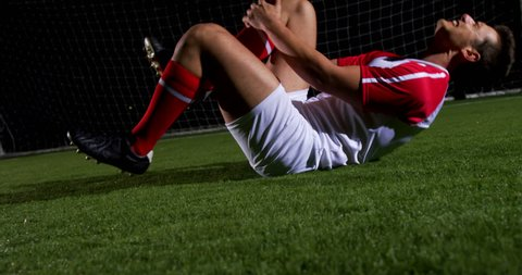 Injured soccer player lying on the playing field 4k