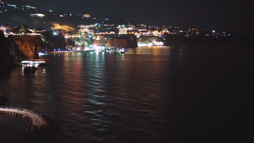 Night scene of Sorrento, the pier with lots of yachts, a corner of the cityscape on a summer night, Italy, travel concept design, city lights | Shutterstock HD Video #32481400