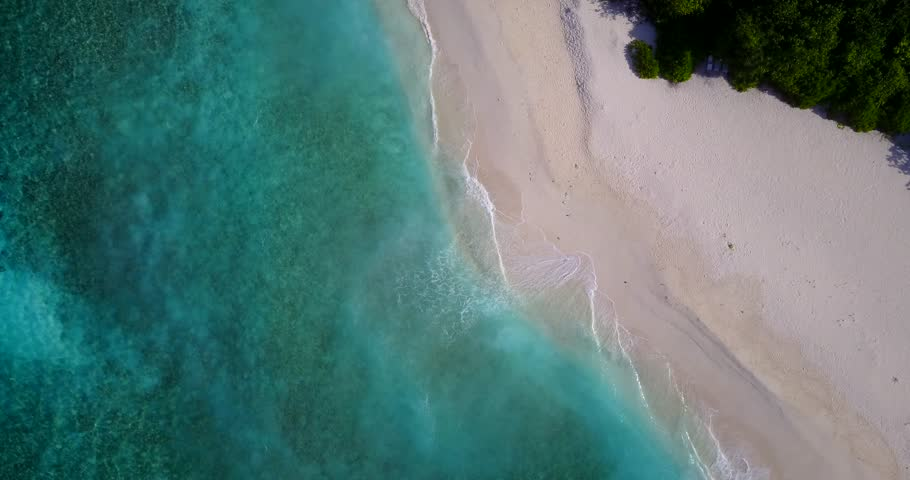 v14722 maldives white sand beach tropical islands with drone aerial flying birds eye view with aqua blue sea water and sunny sky