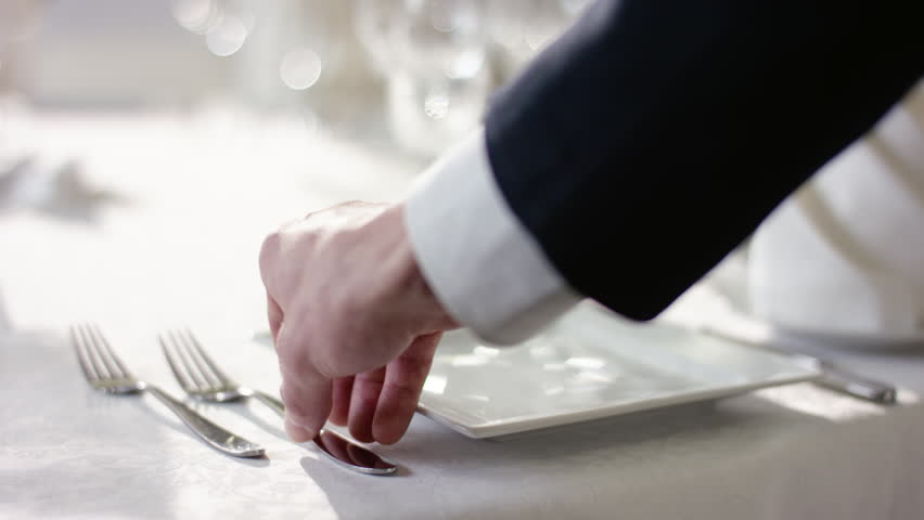 Shot of waiter hand preparing dinner table for celebration at banquet hall | Shutterstock HD Video #32506480