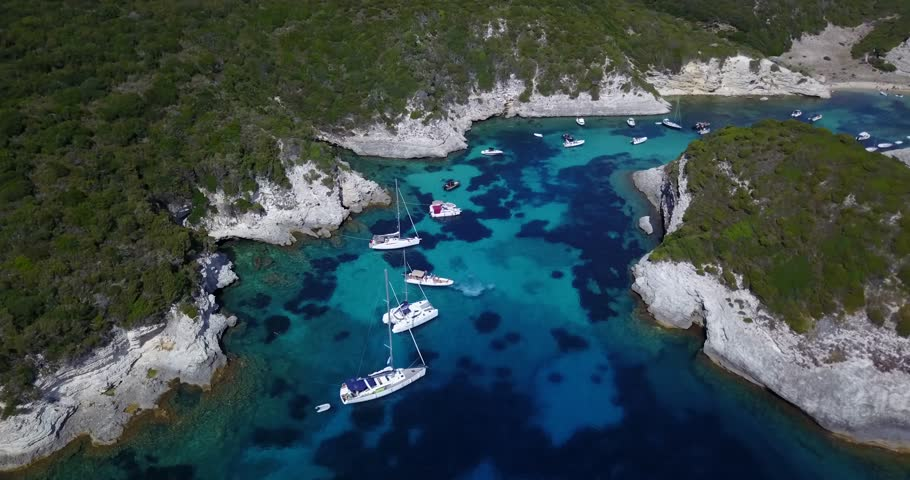 Aerial video taken above Plage de Fazii in Corsica. Yachts. Cliffts. Bonifacio.