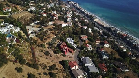 Malibu CA AERIAL houses, beach, LA Calif. Malibu is a city west of Los Angeles, California. It's known for its celebrity homes and beaches