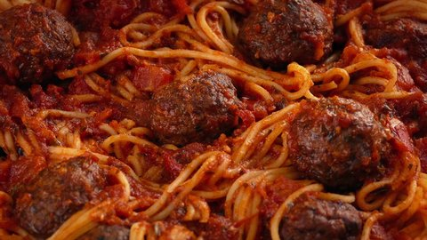 Grated Cheese Sprinkled On Spaghetti And Meatballs