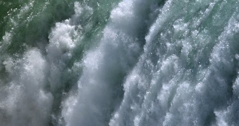SLO MO CU Splashing and glittering waters of Niagara Falls / Canada