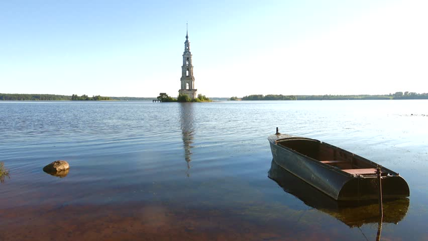 July morning on the Uglich reservoir. View of the flooded belfry of St. Nicholas Cathedral. Kalyazin, Russia