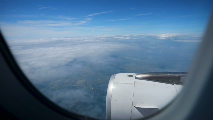 plane window and jet engine flying over white cloud #32587300