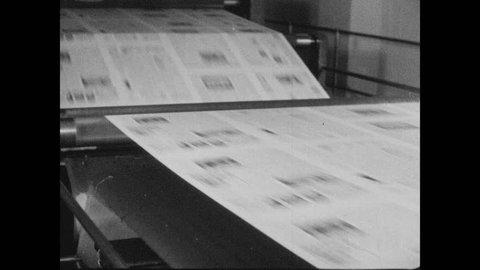 1940s: Newspaper speeds through part of press.