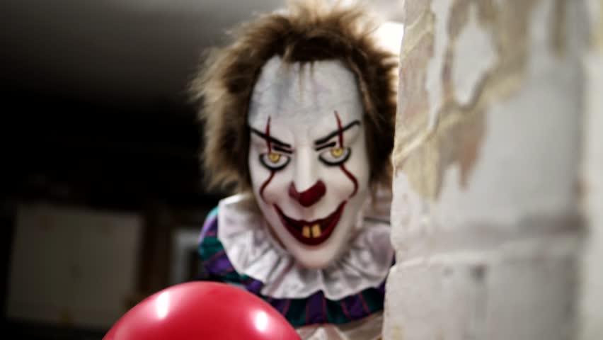 Evil Clown in Dark Scary Halloween Horror Scene, Frightening with Balloon | Shutterstock HD Video #32601820