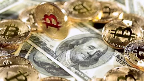 Gold Bit Coin BTC coins and dollar bills. Bitcoin is a worldwide cryptocurrency and digital payment system called the first decentralized digital currency.