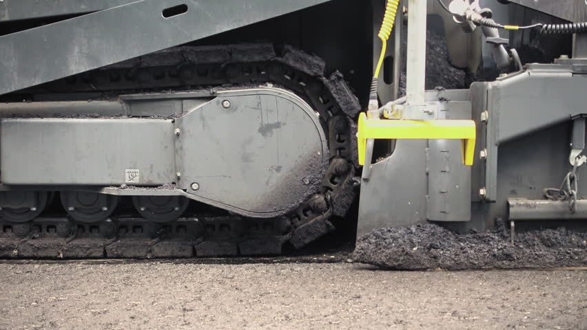 Road construction. Applying new hot asphalt using road construction machinery and power industrial tools. Roadworks repaving process. | Shutterstock HD Video #32617960