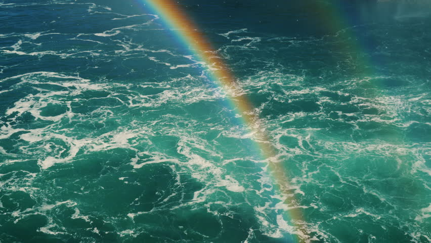 Beautiful rainbow over the stormy waters of the river. The Niagara River between the USA and Canada. 4k 10 bit video | Shutterstock HD Video #32648770