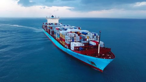 Mediterranean sea - November 2, 2017: Aerial footage of a large Maersk container ship sailing the Mediterranean sea in stormy weather.