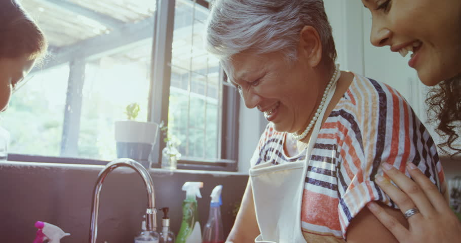 Close-up of grandmother and granddaughter laughing while washing dishes in the sink 4K 4k   Shutterstock HD Video #32740522