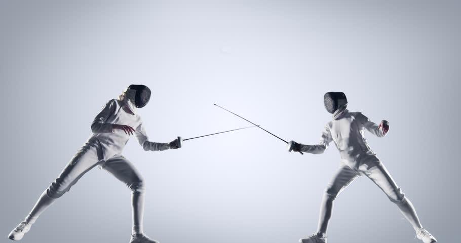 Two fencing sportswomen on white background
