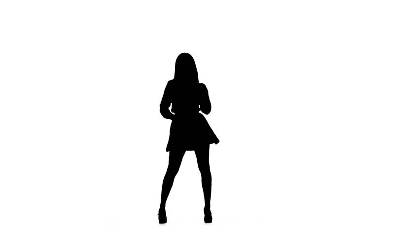 Woman is dancing a sexy dance. Silhouette. White background. Slow motion