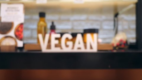 Vegan Sign on Ethical Cosmetics Section Shelf in Shopping Mall. 4K.