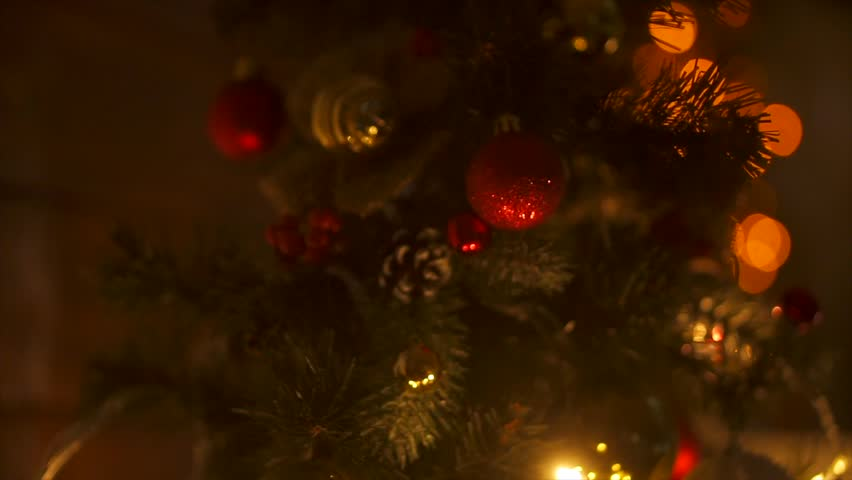 New Year 2019. New Year, new year, light background. New Year mood, Christmas tree, Christmas tree toys. Lights, bokeh. Room, fireplace, Christmas tree, log, Yellow light, red lights. Merry Christmas