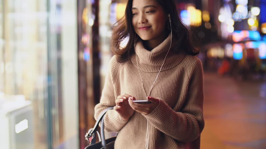 Young asian woman using smartphone in the street at night  | Shutterstock HD Video #32787550