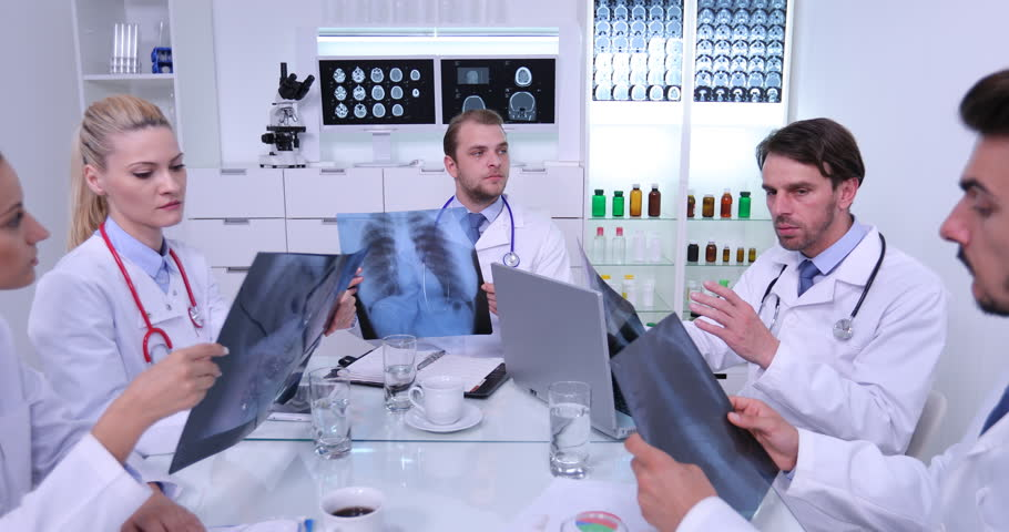 Group of Doctors Discussing Examining Results of Pulmonary X-Ray in Meeting Room | Shutterstock HD Video #32807116
