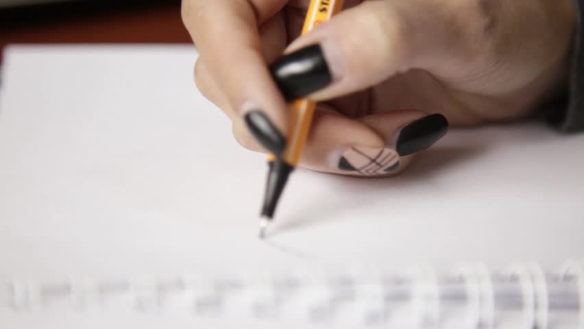 Female hand drawing a abstract flower with pencil in sketchbook | Shutterstock HD Video #32811340