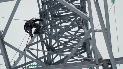 Electrician works on the energy tower