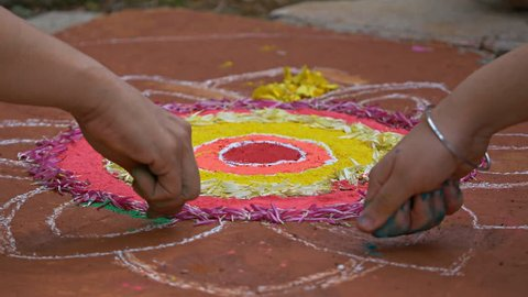 Making of Rangoli during Diwali festival Circa October 2017
