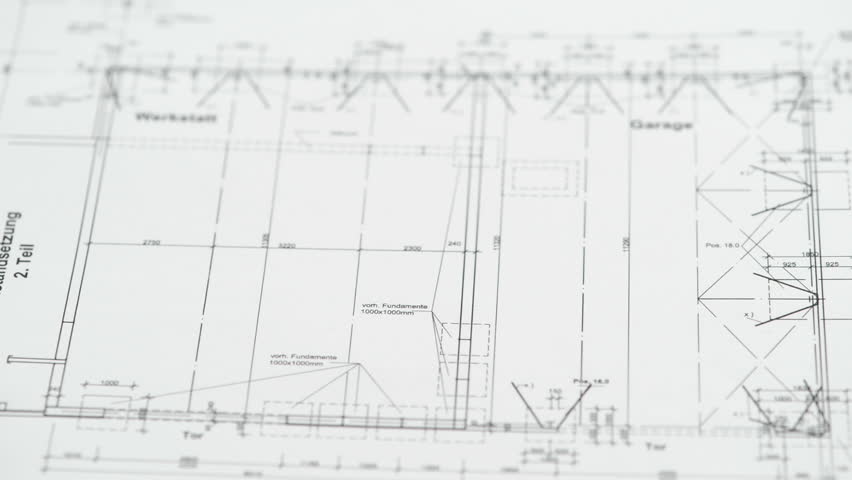 Someone putting blueprint for house construction in german language on table with calculator and drawing compass. | Shutterstock HD Video #3284930