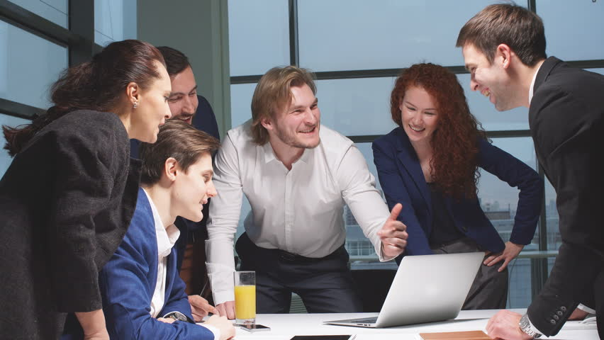 Portrait of young business team at work. Bright contemporary small creative business. Casual young people in new creative business office. | Shutterstock HD Video #32855626