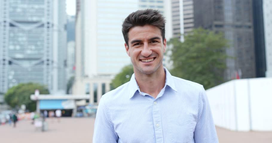 Hispanic businessman smile to camera | Shutterstock HD Video #32864560