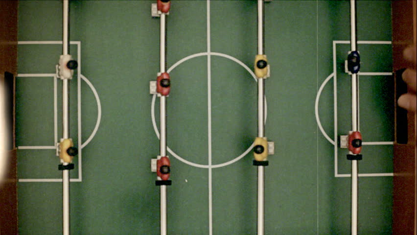 Fake 8mm amateur film: playing table-soccer. Shot from above.  #32891650
