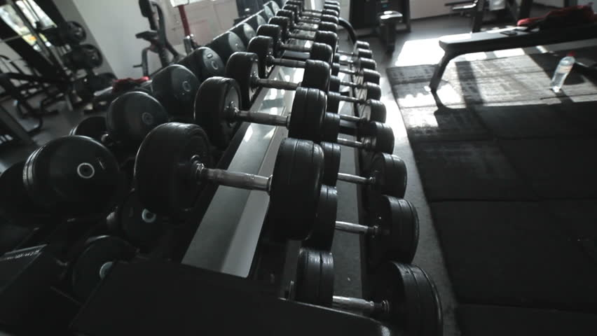 Rows of dumbbells in the gym, simulators for athletes.   Shutterstock HD Video #32910736